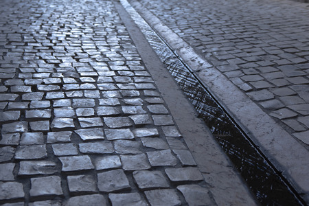paved: Paved street and gutter in the city