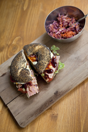 gastronomic: Gastronomic bagel on a wooden board Stock Photo
