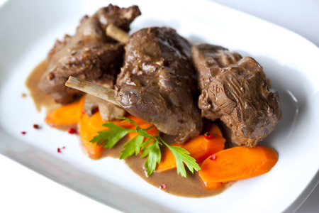 Wild boar stew and carrots on a plate