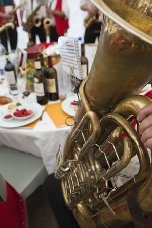 tuba: Playing tuba with a band in a party