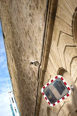 stoned: Mirror and camera on a stoned wall Stock Photo