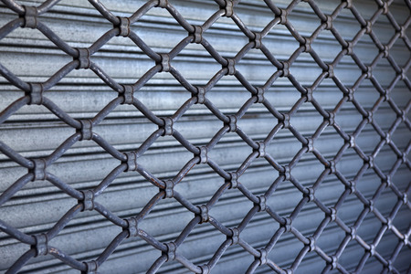 Close up of an iron curtain in the street