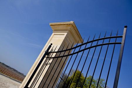 iron gate: Wrought iron gate of a winery near Bordeaux Stock Photo