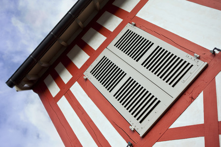 half timbered house: Shutter on an half timbered house in France