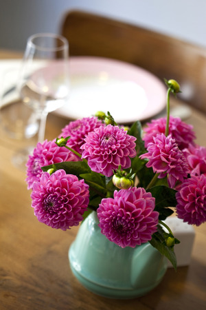 ambiance: Dahlia in a pot on the table of a French bistro Stock Photo