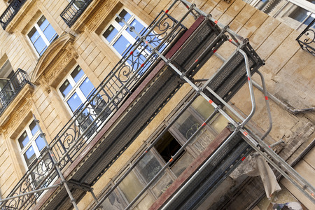 renovate old building facade: Scaffolding on a renovation site in Bordeaux, France Stock Photo