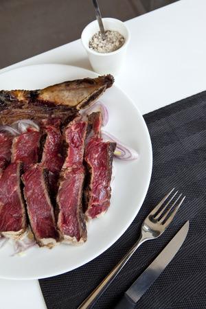 prime rib: Prime rib and shallots on a plate