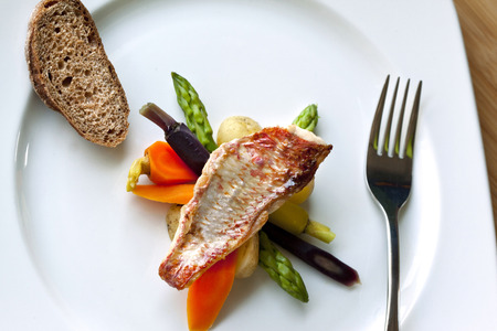 mullet: Red mullet fillet, vegetable and toast on a plate