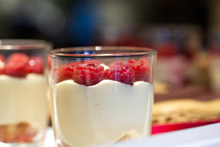 collation: Dessert in a glass with raspberries and vanilla cream Stock Photo