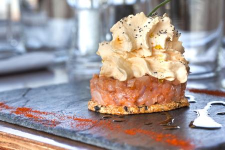 cram: Salmon tartare, olive biscuit and chorizo cram