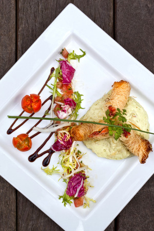 gastronomic: Fried shrimp, Chinese vermicelli, guacamole and salad on a plate