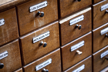 Drawers of a wooden furniture in an old herbalist shop Stock Photo