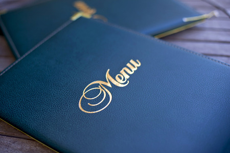 Close up of a stylish menu on the table at a restaurant Foto de archivo
