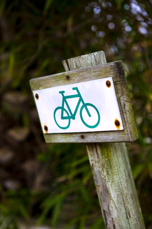 wooden post: Bike sign on a wooden post in the countryside