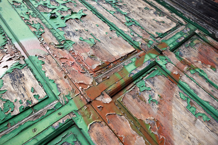 tatty: Damaged painting on an old wooden door Stock Photo