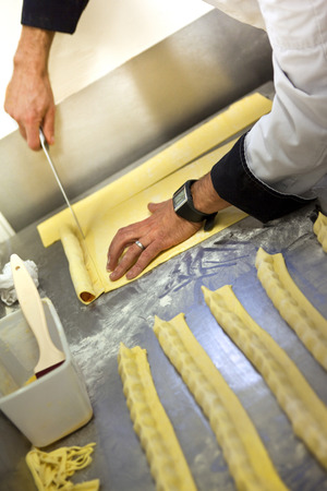 french bakery: Chef making cakes in a French bakery Stock Photo