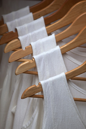 hangers: Hanging clothes on hangers in a fashion store