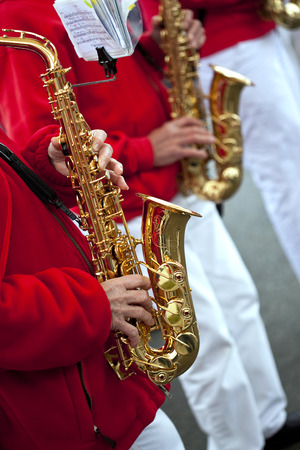 marching band: Saxophonists and instruments playing in a marching band