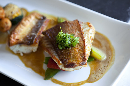 fish dish: Saint-Pierre fish, vegetable, mushrooms and sauce on a plate