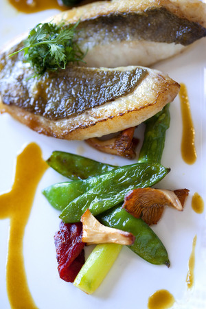 gastronomic: Gastronomic dish with white fish, green vegetable and mushrooms