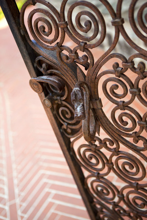 metal gate: Close up of a stylish wrought iron gate Stock Photo