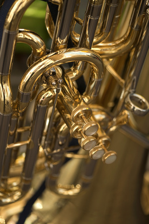 tuba: Close up of details and pistons of a tuba