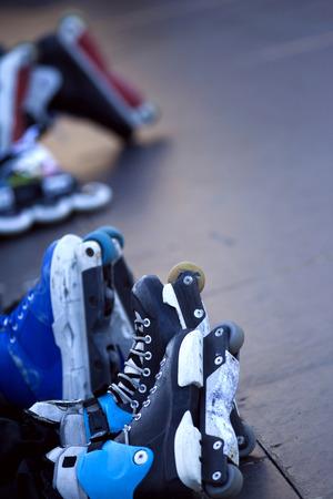 skaters: Skaters and roller skates in a skatepark