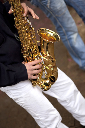 marching band: Saxophonist and his instrument in a marching band