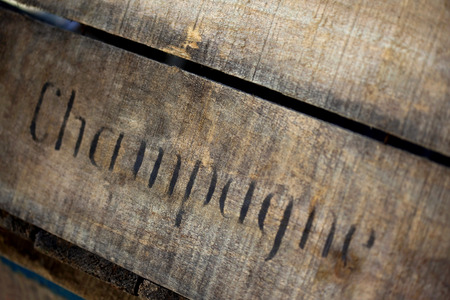Old and weathered wooden box for Champagne bottles