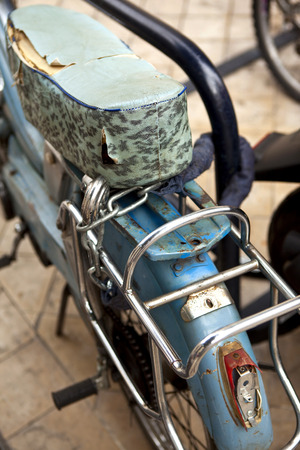 moped: Old damaged moped in a flea market Stock Photo