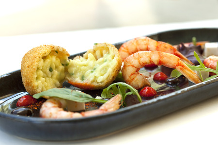 fritters: Risotto fritters, prawns, tomato sauce and olives, coconut cubes