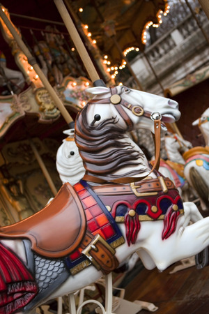fairground: Wooden horse on an old carousel in a French fairground