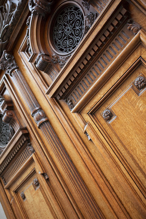 patrimony: Stylish wooden door of a school in Bordeaux, France