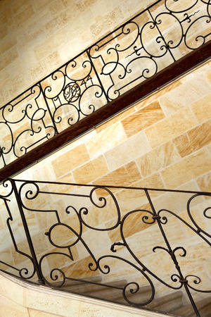 metal handrail: Wrought iron handrail and upstairs in a French mansion