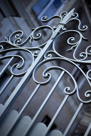 Wrought iron gate in front of a French mansion