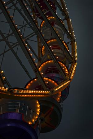 fairground: Lights of a big wheel at dusk in a fairground