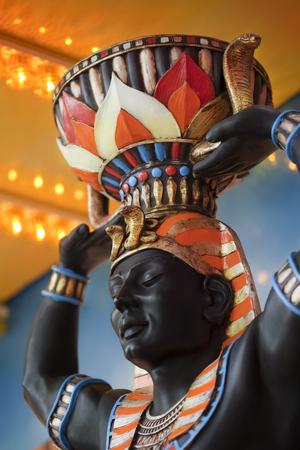 bust: Pharaoh bust cardboard pulp at a fairground