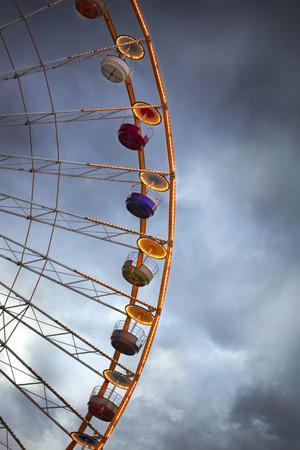big wheel: Big wheel and cloudy sky in a fairground