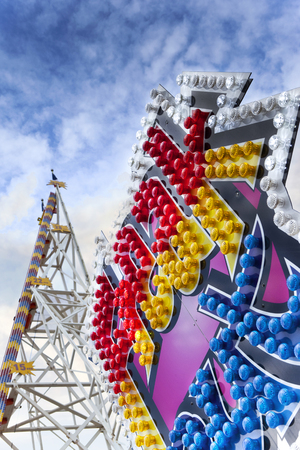 fairground: Colorful bulbs on the facade of a ride in a fairground
