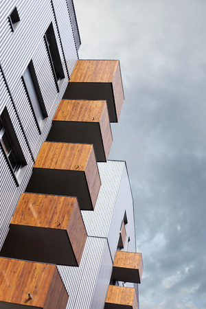 balcony: Wooden balconies on the facade of a modern building