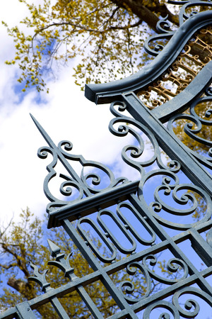 entrance gate: Detail of an old wrought iron gate in a French park Stock Photo