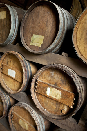 wine stocks: Close up of oak barrel in a French cellar Stock Photo