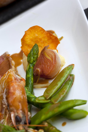mullet: Shrimp, red mullet, asparagus and shallots on a plate Stock Photo