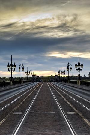 tramline: Tramline on a stone bridge in Bordeaux at dusk