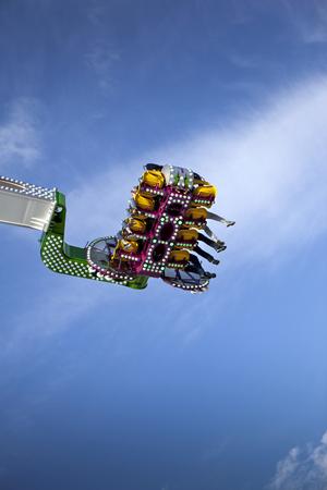 fairground: Teens on a ride at the fairground