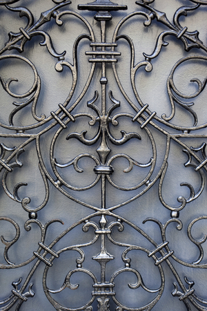 french doors: Detail of a wrought iron door of French mansion