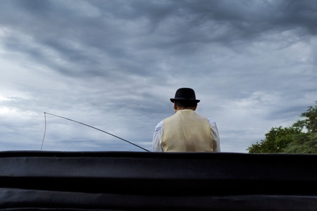 coachman: Coachman in a carriage, cloudy sky on background