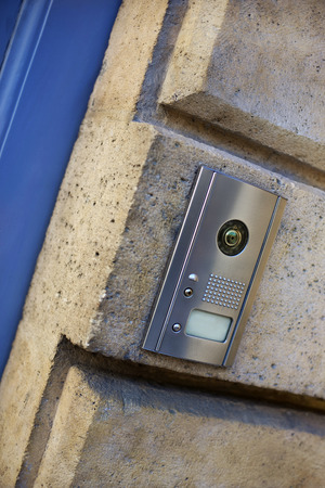 adress: Modern intercom on the stone wall of an old French house
