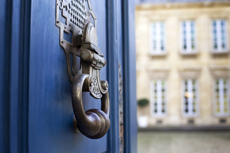 Wrought iron knocker on a classic wooden door