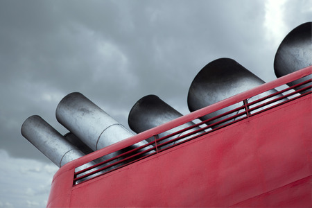 close up chimney: Close up of chimneys of a cruise ship and cloudy sky